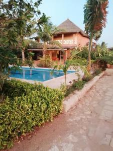 The swimming pool at or near Villa Pat & Diouma