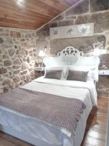 Cama o camas de una habitación en A Casiña Vella