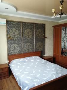 A bed or beds in a room at Daily rent Apartments 4