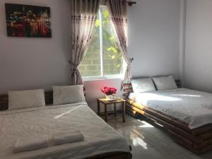 Кровать или кровати в номере Mui Ne Sunlight Villa