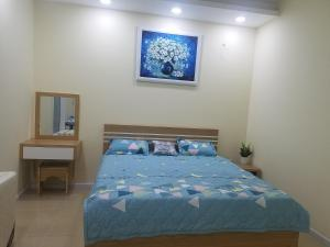 A bed or beds in a room at Mina house