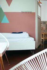 A bed or beds in a room at Hostel & Garten Eden