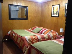 A bed or beds in a room at Lafquen