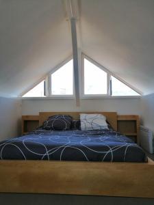 Un ou plusieurs lits dans un hébergement de l'établissement Toi Toit, Mon Toit