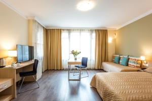 A seating area at Geneva Hotel