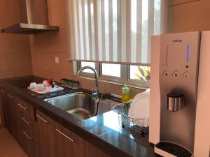 A kitchen or kitchenette at Fuuka Villa