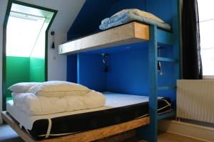 A bunk bed or bunk beds in a room at Globalhagen Hostel