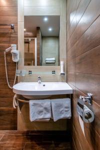 Łazienka w obiekcie Hotel Olympie