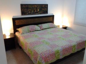 Letto o letti in una camera di Mamma Rosa Aparthotel