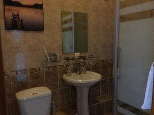 A bathroom at Altyn Adam Hotel