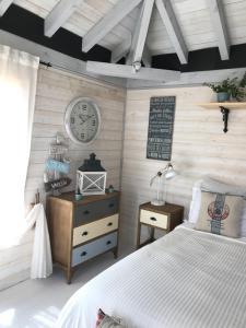 Un ou plusieurs lits dans un hébergement de l'établissement Maison & Tartine