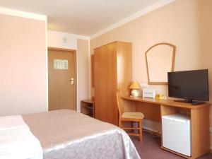 Кровать или кровати в номере Август Отель