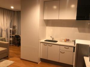 A kitchen or kitchenette at Yokohama WORLD Family House