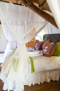 A bed or beds in a room at Blyde River Canyon Lodge