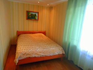 Un ou plusieurs lits dans un hébergement de l'établissement Furnished Apartments on Sovetskaya