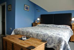 A bed or beds in a room at Drumcreehy Country House B&B