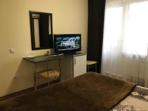 Телевизор и/или развлекательный центр в Апарт-отель Yuzhniy