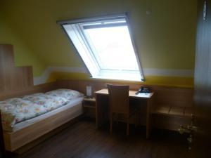 Ein Bett oder Betten in einem Zimmer der Unterkunft Hotel Thünenhof