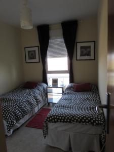 A bed or beds in a room at Apartamento La Figuereta, Isla Cristina