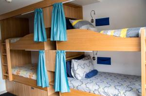 A bunk bed or bunk beds in a room at Adventure Q2 Hostel