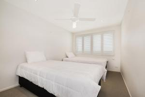 A bed or beds in a room at 7 Wharf Street