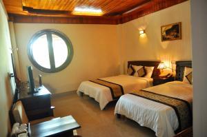 A bed or beds in a room at Sa Huynh Resort