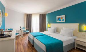 En eller flere senge i et værelse på Hotel Terrace Beach Resort All Inclusive