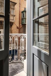 A balcony or terrace at Jean de Valette Boutique Living