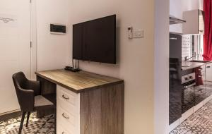 A television and/or entertainment center at Jean de Valette Boutique Living