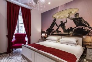 A bed or beds in a room at Jean de Valette Boutique Living