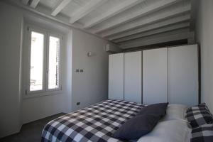 Letto o letti in una camera di Piazza Trento 11