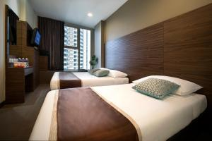 A bed or beds in a room at Value Hotel Thomson (SG Clean)