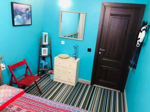 Телевизор и/или развлекательный центр в First Hostel