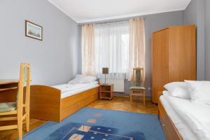 Łóżko lub łóżka w pokoju w obiekcie Apartamenty Zielony przy MTP