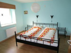 Ein Bett oder Betten in einem Zimmer der Unterkunft B&B Der Schmetterling