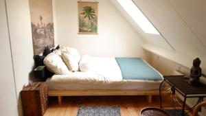A bed or beds in a room at Vegotel