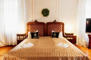 "A bed or beds in a room at Hotel & Restaurant ""Deutscher Kaiser"""