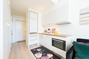 A kitchen or kitchenette at Nordic Host - Tollbugata 13