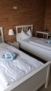 Ein Bett oder Betten in einem Zimmer der Unterkunft GZ Hostel Bornheim