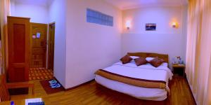 A bed or beds in a room at Inle Star Hotel
