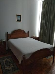 A bed or beds in a room at Residencial Real - Antiga Rosas