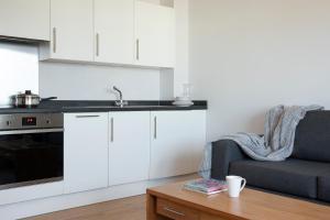 A kitchen or kitchenette at SACO Aparthotel Farnborough