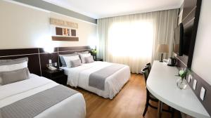 A bed or beds in a room at Hotel Premium Campinas
