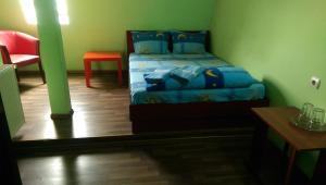 Un pat sau paturi într-o cameră la Hotel Casa Verde Prosper