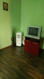 Un televizor și/sau centru de divertisment la Hotel Casa Verde Prosper