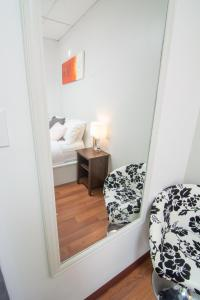 A bed or beds in a room at Wicked Hostels - Calgary