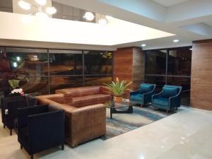 The lobby or reception area at Café Hotel Medellín
