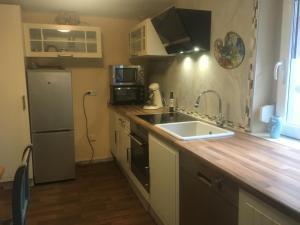 Küche/Küchenzeile in der Unterkunft Gästehaus Chateau d'Orsay