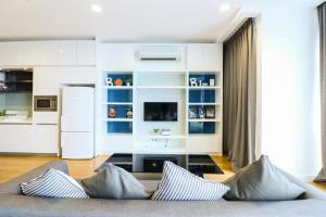 Coin salon dans l'établissement Victoria Home Platinum Suites