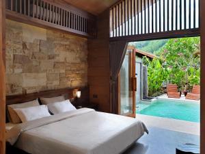 Ein Bett oder Betten in einem Zimmer der Unterkunft Batatu Villas